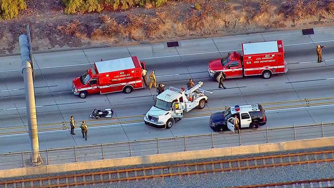 Authorities appear at the scene of a crash on the 105 Freeway involving two L.A. County sheriffs motorcycle deputies on Thursday, Dec. 5, 2013.