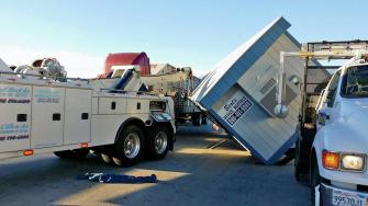 Winds in Fontana knocked over a trailer onto a cattle truck Monday, Dec. 9, 2013. No one was hurt.