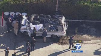 A charred body was found in a burned up van in South Los Angeles on Tuesday, Dec. 10, 2013. Police say the man may have been stealing gas from a nearby gas station.