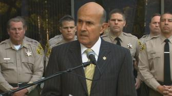 L.A. Sheriff Lee Baca talks at a news conference on Monday, Dec. 9, 2013.