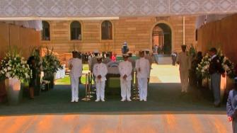 Naval officers stand guard at the coffin of Nelson Mandela on Wednesday, Dec. 11, 2013.