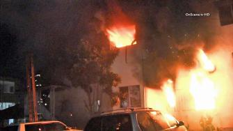 A fire at an apartment building in Echo Park is seen Thursday, Dec. 12, 2013.