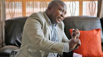 Thamsanqa Jantjie gestures at his home during an interview with the Associated Press in Johannesburg, South Africa,Thursday, Dec. 12, 2013.