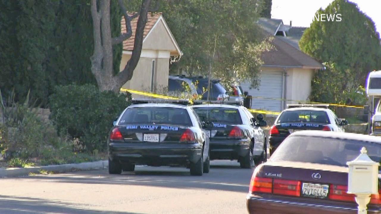 Simi Valley police investigate a shooting in a Simi Valley neighborhood that left one woman dead and a man wounded on Saturday, Dec. 28, 2013.