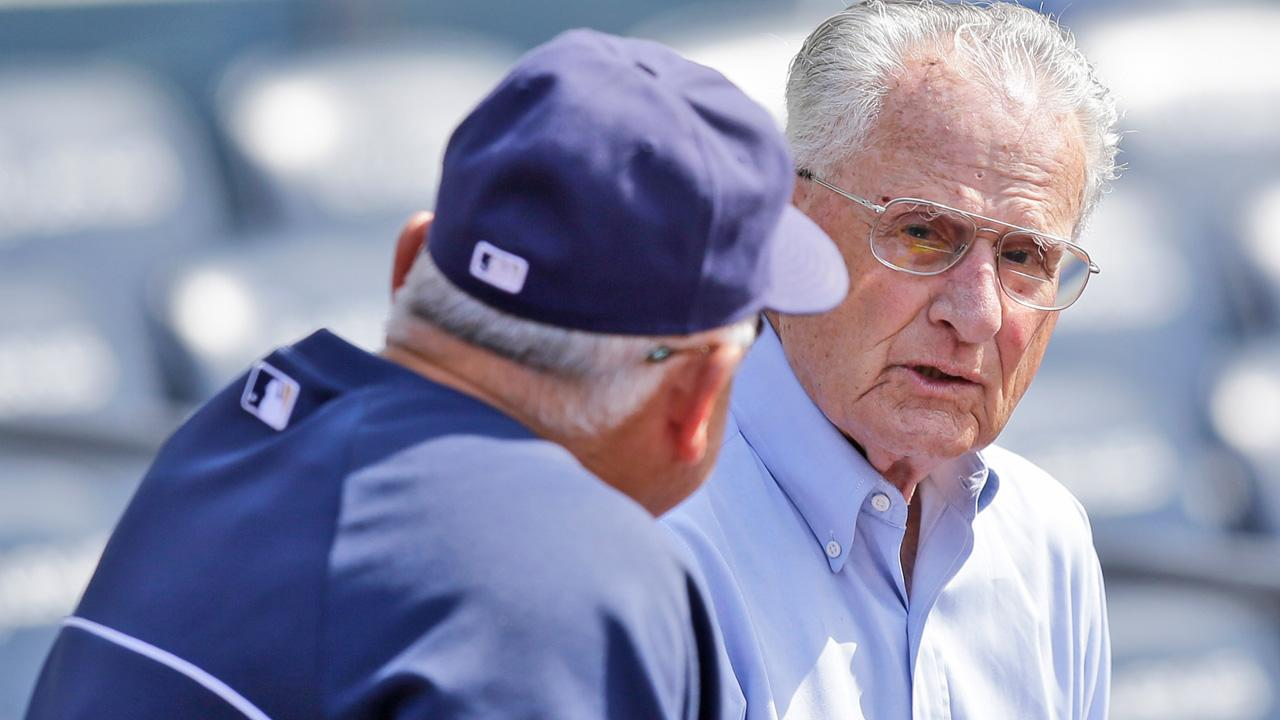 New York Yankee legend and long time San Diego Padres broadcaster Jerry Coleman talks with Padres coach Rick Renteria prior to a baseball game in San Diego, Tuesday, June 11, 2013.Lenny Ignelzi