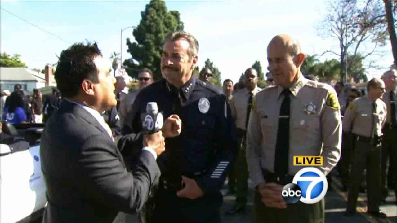 LAPD Chief Charlie Beck and Los Angeles County Sheriff Lee Baca greet the crowd during the Kingdom Day Parade in South Los Angeles on Monday, Jan. 20, 2014.