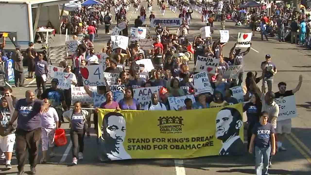 The Martin Luther King Community Coalition marches in the Kingdom Day Parade in South Los Angeles on Monday, Jan. 20, 2014.