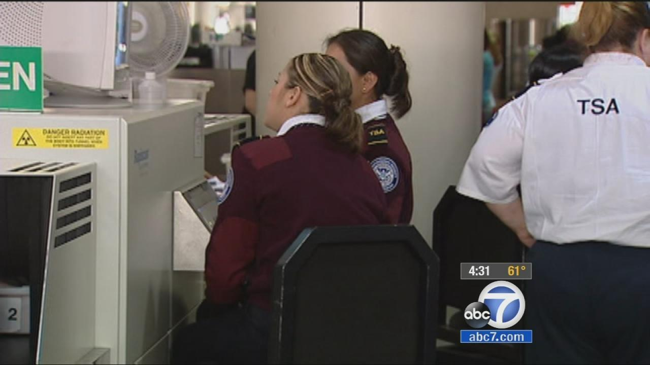 TSA officers are seen at an airport checkpoint in this undated file photo.