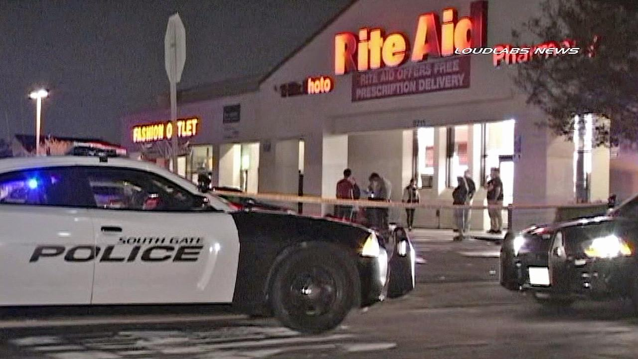Authorities investigate a shooting at Rite Aid in South Gate on Sunday, Feb. 9, 2014.