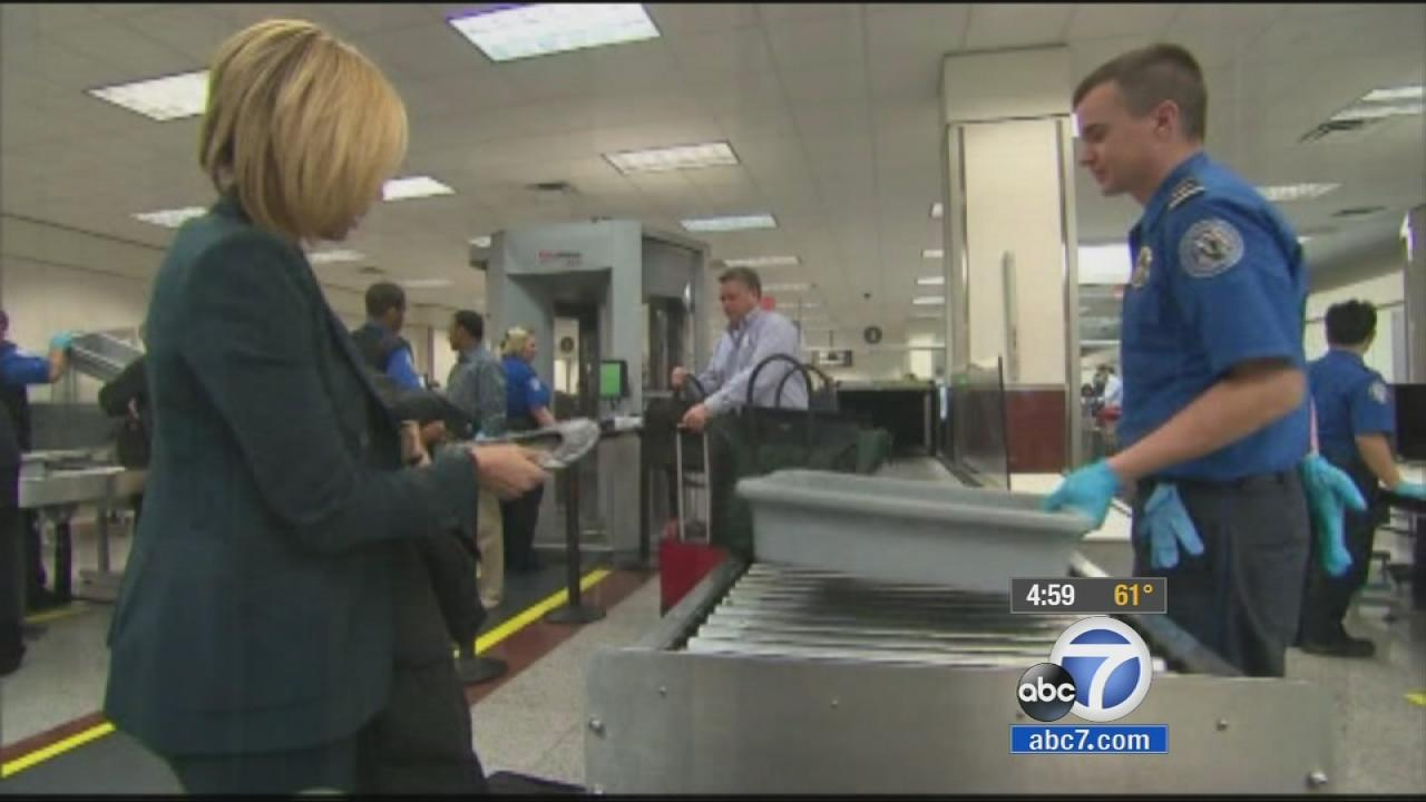 A traveler takes off her shoes at an airport security checkpoint in this undated file photo.