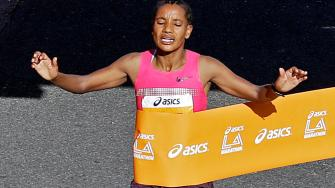 Amane Gobena, of Ethiopia, wins the womens division in the Los Angeles Marathon in Santa Monica, Calif., Sunday, March 9, 2014. She finished in 2 hours, 27 minutes, 37 seconds.