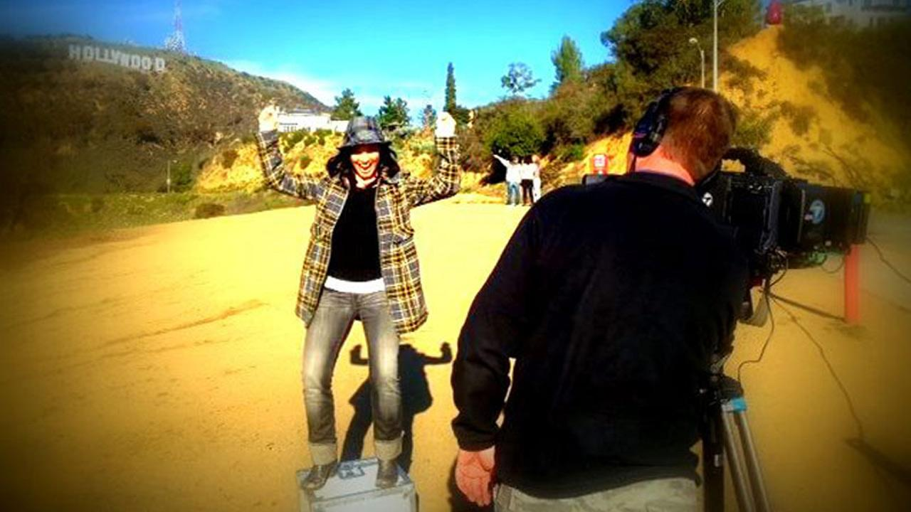 Eye on LA host Tina Malave is seen near the Hollywood sign in this undated photo.