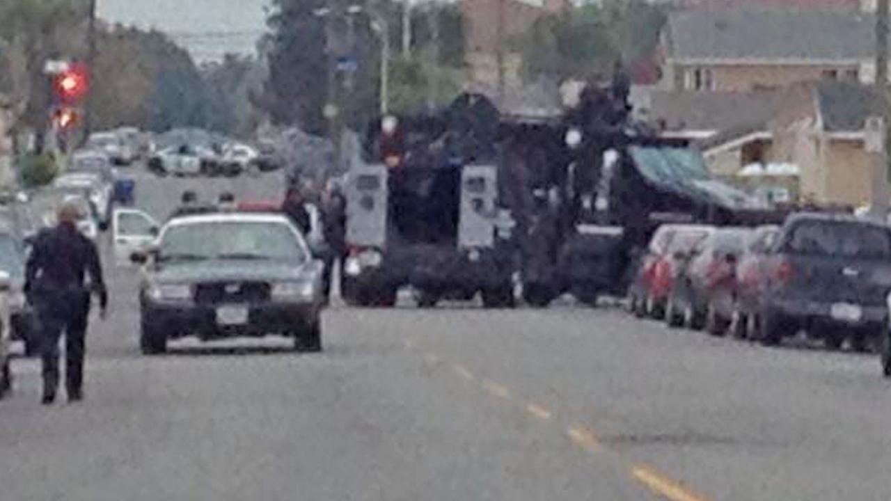 Authorities at the scene of a standoff in South Los Angeles on Saturday, April 12, 2014.