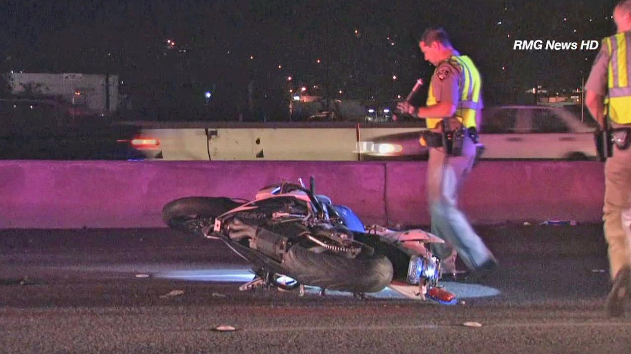 Authorities investigate a motorcycle crash on the I-5 in Burbank on Saturday, May 3, 2014.