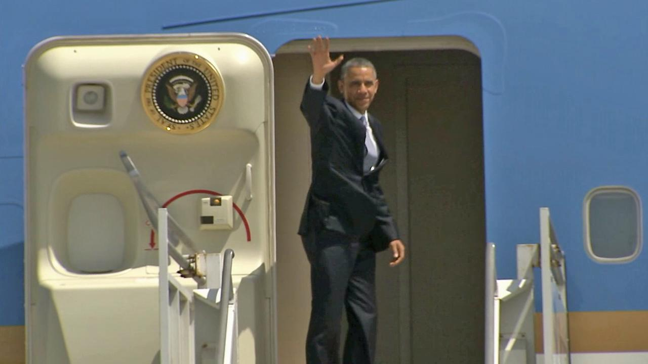 President Barack Obama waves goodbye before boarding Air Force One at LAX on Thursday, May 8, 2014.