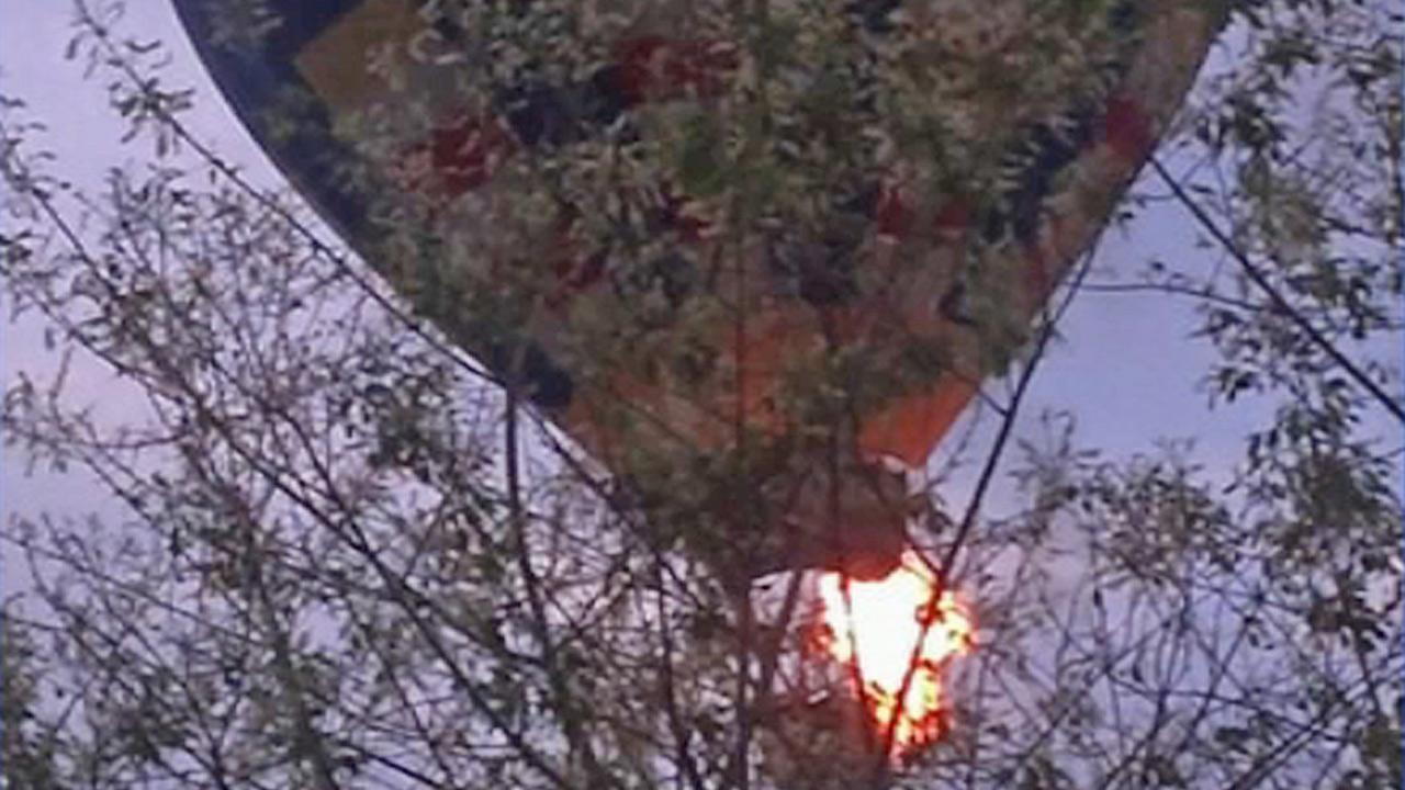A hot-air balloon catches fire Friday, May 9, 2014.