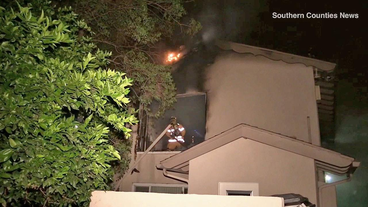 Firefighters battle a blaze at an apartment building in Anaheim on Saturday, May 10, 2014.