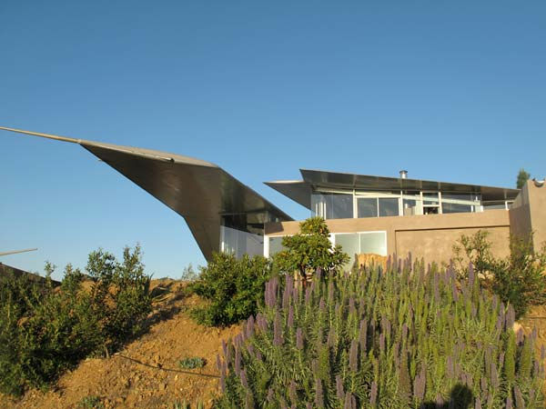 The wings of a deconstructed Boeing 747 airplane were transported to a 55-acre property in Malibu to form a unique Wing House on the cliffs with a view of the Pacific Ocean.