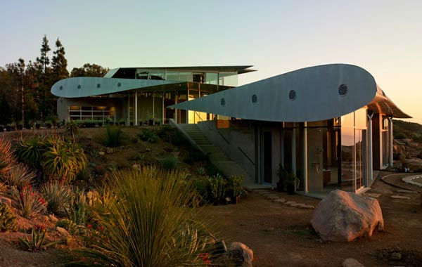 The wings of a deconstructed Boeing 747 airplane were transported to a 55-acre property in Malibu to form a unique Wing House on the cliffs with a view of the Pacific Ocean. The design is by David Hertz Architects Inc. and was completed in May 2011. The main residence uses both main wings as well as 2 stabilizers from the tail section. The art studio building uses a 50-foot long section of the upper fuselage as a roof, while the remaining front portion of the fuselage and upper first class cabin deck was used as the roof of the guest house. <span class=meta>(Courtesy DAVID HERTZ FAIA ARCHITECT, VENICE, CA)</span>