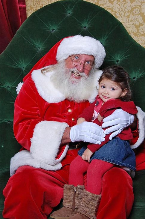 ABC7 viewer Christina Lujan posted this photo to the ABC7 Facebook wall of her daughter Abbey, who clearly wasn&#39;t too impressed with Santa Claus.   Post your own photo, and don&#39;t forget to tag yourself. Your photo may be used on Eyewitness News! <span class=meta>(KABC Photo&#47; ABC7 viewer Christina Lujan)</span>