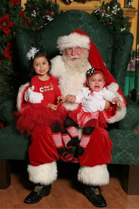 "<div class=""meta ""><span class=""caption-text "">ABC7 viewer Ervin Mendez posted this photo to the ABC7 Facebook wall of two sisters who had very different opinions about Santa Claus.  Post your own photo, and don't forget to tag yourself. Your photo may be used on Eyewitness News! (KABC Photo/ ABC7 viewer Ervin Mendez)</span></div>"