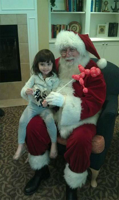 "<div class=""meta ""><span class=""caption-text "">ABC7 viewer Heather Salazar posted this photo to the ABC7 Facebook wall of her granddaughter Khloe with Santa Claus.  Post your own photo, and don't forget to tag yourself. Your photo may be used on Eyewitness News! (KABC Photo/ ABC7 viewer Heather Salazar)</span></div>"