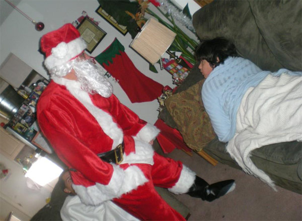 "<div class=""meta ""><span class=""caption-text "">ABC7 viewer Gabby Marcelo De La Torre posted this awkward Santa photo to the ABC7 Facebook wall.  Post your own photo, and don't forget to tag yourself. Your photo may be used on Eyewitness News! (KABC Photo/ ABC7 viewer Gabby Marcelo De La Torre)</span></div>"