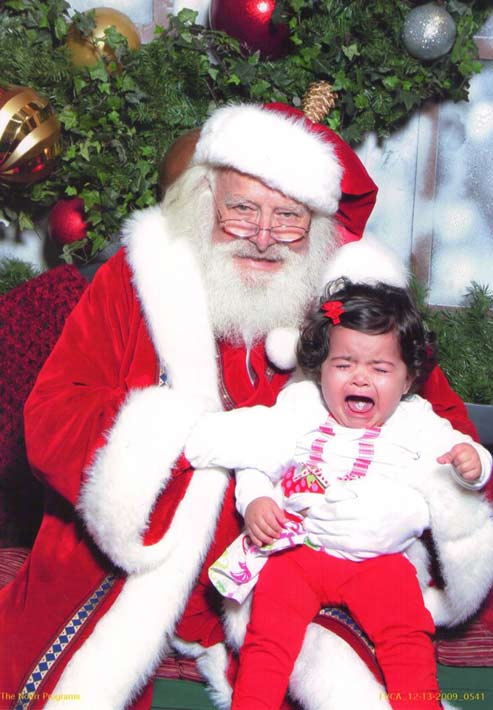 "<div class=""meta ""><span class=""caption-text "">ABC7 viewer Elizabeth Reyes posted this photo to the ABC7 Facebook wall of her 1-year-old daughter with Santa.  Post your own photo, and don't forget to tag yourself. Your photo may be used on Eyewitness News!  (KABC Photo/ ABC7 viewer Elizabeth Reyes)</span></div>"