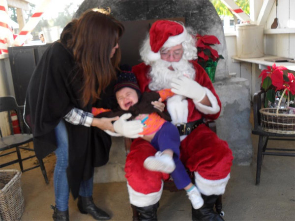 ABC7 viewer Cecilia Caceres posted this awkward Santa photo to the ABC7 Facebook wall.  Post your own photo, and don&#39;t forget to tag yourself. Your photo may be used on Eyewitness News! <span class=meta>(KABC Photo&#47; ABC7 viewer Cecilia Caceres)</span>