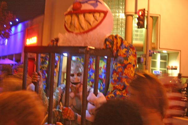 A caged clown at the West Hollywood Halloween Costume Carnaval in West Hollywood on Wednesday, Oct. 31, 2012.