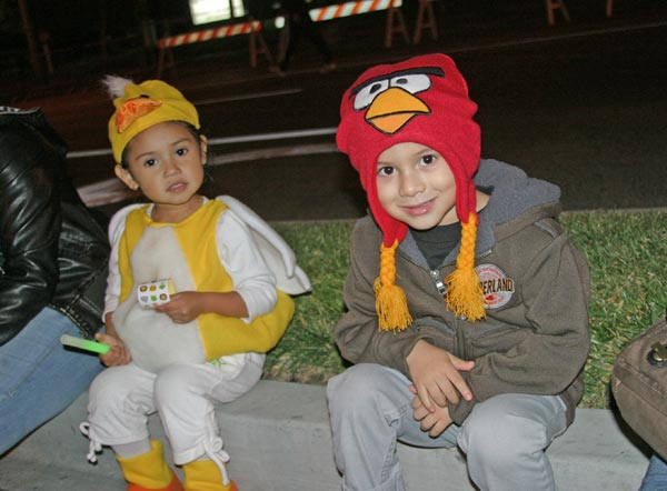 Children take a rest during the West Hollywood Halloween Costume Carnaval in West Hollywood on Wednesday, Oct. 31, 2012.