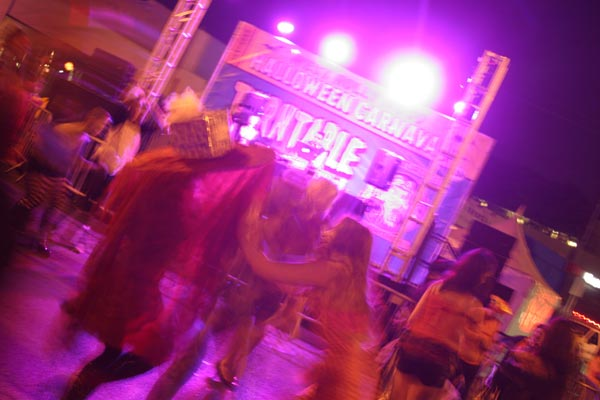 Revelers dance during a musical act at the West Hollywood Halloween Costume Carnaval in West Hollywood on Wednesday, Oct. 31, 2012.