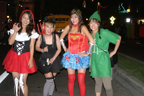 Revelers stop to pose for a picture during the West Hollywood Halloween Costume Carnaval in West Hollywood on Wednesday, Oct. 31, 2012.