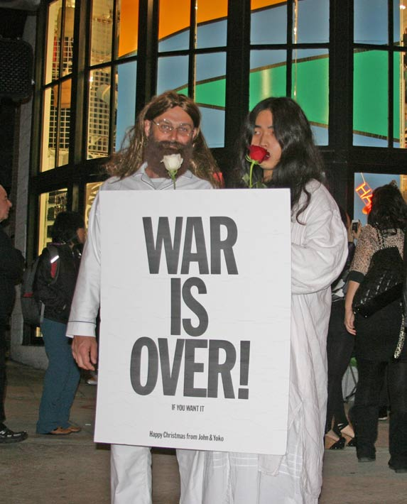 "<div class=""meta ""><span class=""caption-text "">Revelers dressed as John Lennon and Yoko Ono at the West Hollywood Halloween Costume Carnaval in West Hollywood on Wednesday, Oct. 31, 2012. (ABC7)</span></div>"
