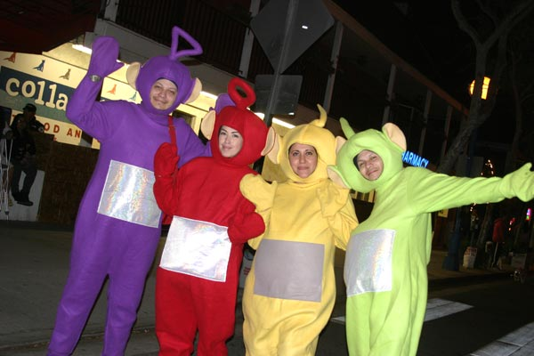 Revelers dressed as the Teletubbies at the West...