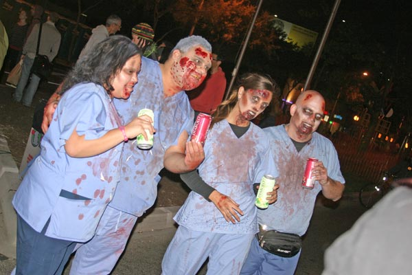 Revelers in zombie costumes at the West...