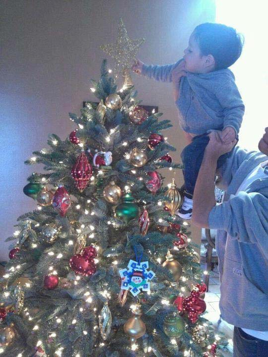 ABC7 viewer Yolanda Rodriguez sent in this photo of her son Adam hanging the star on top of the Christmas tree.