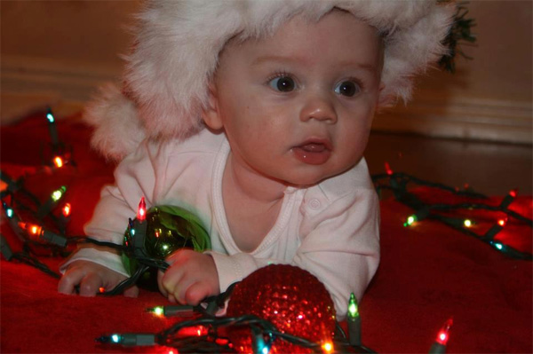 Here is a shot of a baby crawling over lights and christmas bulbs. &#160;Share your holiday pictures with us on our ABC7 Facebook page. <span class=meta>(ABC7 viewer Melissa Laster)</span>