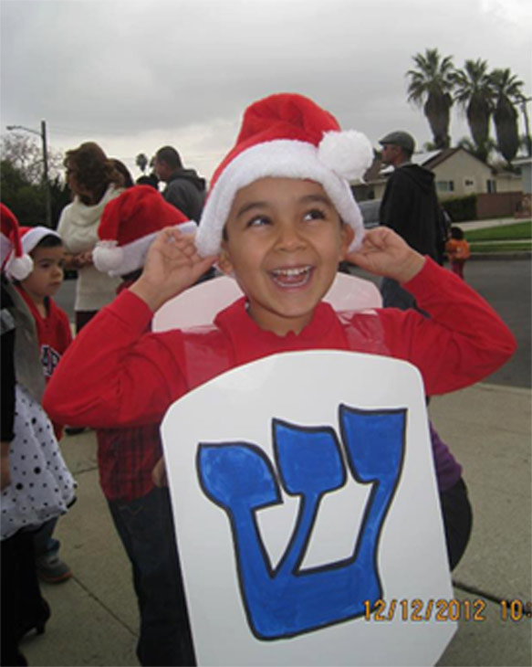 Boy in Santa hat and Hannukah gear &#160;Share your holiday pictures with us on our ABC7 Facebook page. <span class=meta>(ABC7 viewer Laury Godoy)</span>