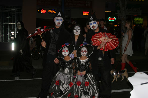 "<div class=""meta ""><span class=""caption-text "">The Lopez family poses for a photo during the West Hollywood Halloween Costume Carnaval on Thursday, Oct. 31, 2013. (ABC7)</span></div>"