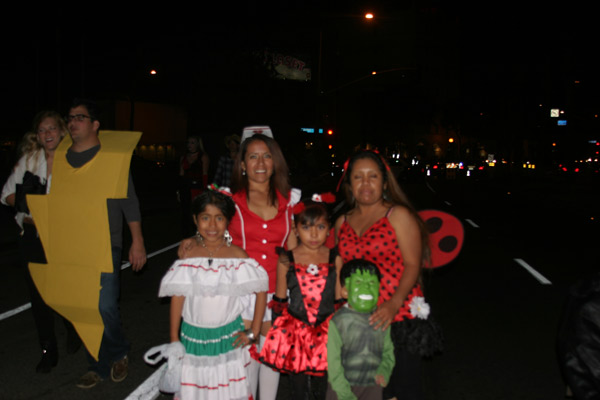 "<div class=""meta ""><span class=""caption-text "">A family poses for a photo during the West Hollywood Halloween Costume Carnaval on Thursday, Oct. 31, 2013. (ABC7)</span></div>"