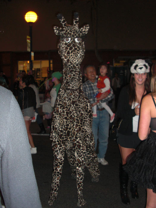 "<div class=""meta ""><span class=""caption-text "">A person dressed up as a giraffe during the West Hollywood Halloween Costume Carnaval on Thursday, Oct. 31, 2013. (ABC7)</span></div>"