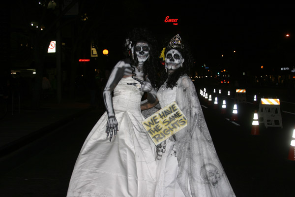 "<div class=""meta ""><span class=""caption-text "">Javier and Victor pose for a photo during the West Hollywood Halloween Costume Carnaval on Thursday, Oct. 31, 2013. (ABC7)</span></div>"