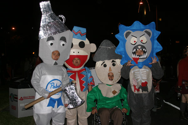 "<div class=""meta ""><span class=""caption-text "">Pouria Ghazal, Henry Leong, Jennifer Tigno and Henry Ngo dress up as characters in 'The Wizard of Oz' during the West Hollywood Halloween Costume Carnaval on Thursday, Oct. 31, 2013. (ABC7)</span></div>"