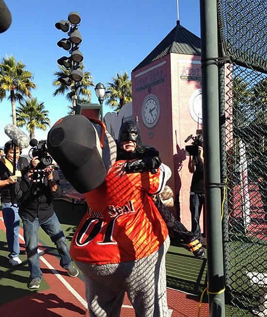 "<div class=""meta image-caption""><div class=""origin-logo origin-image ""><span></span></div><span class=""caption-text"">Batkid gets a big hug from San Francisco Giants mascot Lou Seal after rescuing him from the Penguin at AT&T Park on Friday, Nov. 15, 2013. (KGO-TV)</span></div>"