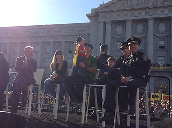 Batkid sits next to his family, Mayor Ed Lee and San Francisco police in front of City Hall on Friday, Nov. 15, 2013.  Miles Scott was called into service on Friday morning by San Francisco Police Chief Greg Suhr to help fight crime, as San Francisco turned into Gotham City as city officials helped fulfill the 5-year-old leukemia patient&#39;s wish to be &#39;Batkid,&#39; The Greater Bay Area Make-A-Wish Foundation says. He was diagnosed with leukemia when he was 18 months old, finished treatment in June and is now in remission. <span class=meta>(KGO-TV)</span>