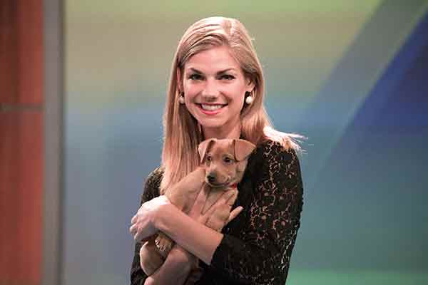 "<div class=""meta image-caption""><div class=""origin-logo origin-image ""><span></span></div><span class=""caption-text"">ABC7 Eyewitness News meteorologist Bri Winkler poses with a 2-month-old Chihuahua named Lester during ABC7's 'Puppypalooza' on Friday, March 21, 2014.</span></div>"