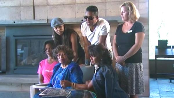 With her children by her side, Jackson family matriarch Katherine Jackson (bottom row center) speaks out against rumors of her whereabouts and health on Wednesday, July 25, 2012.