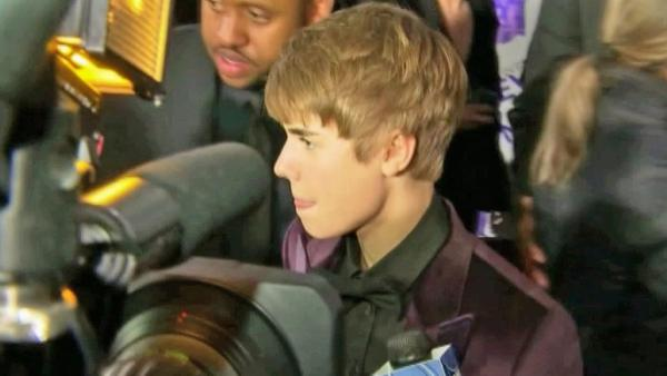 Pop star Justin Bieber is seen surrounded by cameras in this undated file photo.