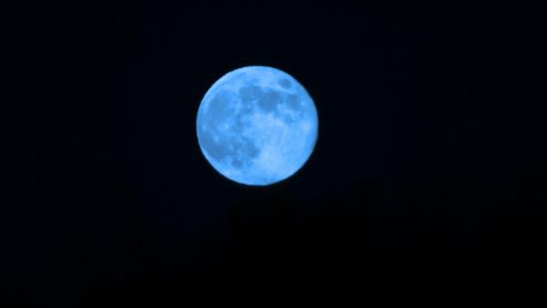 ABC7 viewer Kay Garner Grewal sent us this photo of the blue moon slightly enhanced with color.